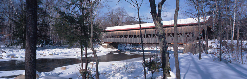 A winter's day at Dugway Covered Bridge, off the Kancamagus Highway, White Mountains, New Hampshire. Photograph by Peter E. Randall.