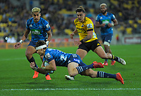 Hurricanes' Peter Umaga-Jensen chases a kick as Blues' Beauden Barrett defends during the Super Rugby Aotearoa match between the Hurricanes and Blues at Sky Stadium in Wellington, New Zealand on Saturday, 18 July 2020. Photo: Dave Lintott / lintottphoto.co.nz