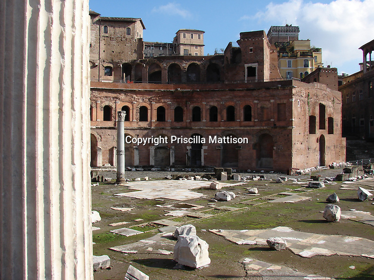 Rome, Italy - January 27, 2007:  A ridged column stands in front of other remains of Trajan's Market.