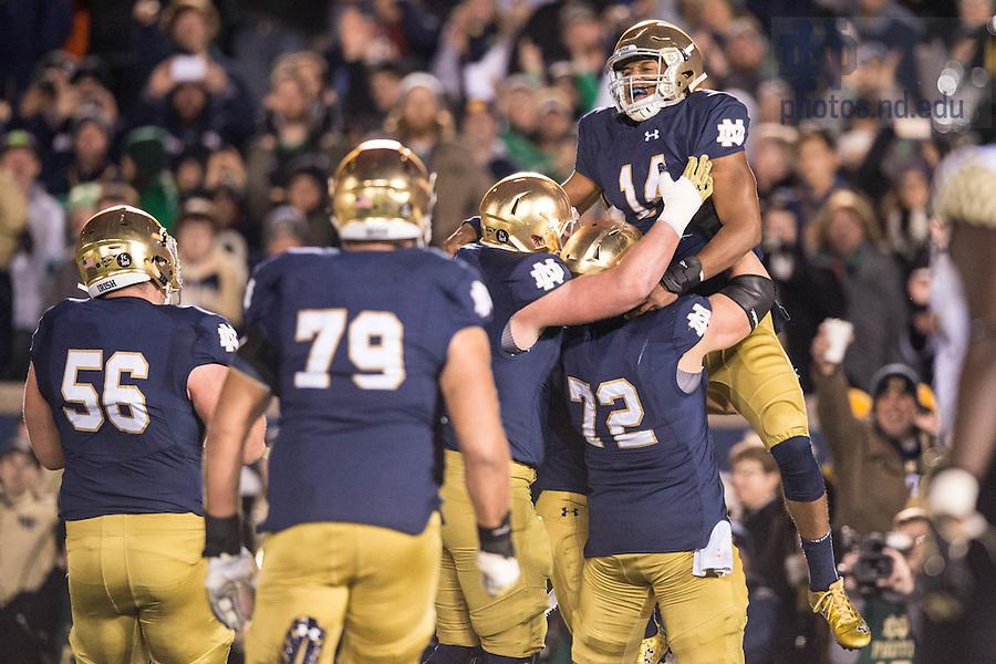 Nov. 14, 2015; Quarterback DeShone Kizer (14) celebrates a touchdown in the fourth quarter against Wake Forest. Notre Dame won 28-7. (Photo by Matt Cashore)