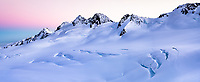 Dawn twilight over mountain ranges of Southern Alps with Explorer Glacier crevasses in upper parts of Fox Glacier NEVE, Westland Tai Poutini National Park, West Coast, UNESCO World Heritage Area, New Zealand, NZ