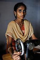 """INDIA Tamil Nadu Dindigul, portraits of young women which have worked in spinning units under the Sumangali scheme, a contract system, in which they are exploited instead of receiving a training and often do not receive the promised salary at the end of the contract / INDIEN Tamil Nadu, Dindigul , Portraets von Frauen die in der Textilindustrie in Spinnereien im Sumangali System gearbeitet haben, Sumangali bedeutet """"glueckliche Braut"""" und ist eine Form von Zwangsarbeit, junge Frauen erhalten einen Vertrag mit Versprechen auf Ausbildung und Zahlung einer Einmalsumme zum Ende der Laufzeit, sie arbeiten oft unter menschenunwuerdigen Bedingungen, werden teilweise sexuell von Vorarbeitern belaestigt und erhalten in vielen Faellen nicht die versprochene Entlohnung, , werden jungen Frauen die NGO´s SSSSS und SAVE vertreten die Frauen rechtlich um ihre Ansprueche geltend zu machen, Ausbildung der Frauen durch NGO SSSSS in einem village center"""