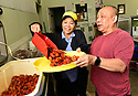 Mary and John Nguyen, owners of Banh Mi Boys serve boiled crawfish with all of the fixings.