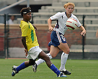 Lori Chalupny v Formiga.US Women's National Team vs Brazil at Legion Field in Birmingham, Alabama.