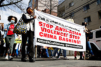 QUEENS - NEW YORK - MARCH 27: Supporters of the Asian-American community hold signs during a Nationwide Day of Action rally Against anti-Asian violence at the Flushing neighborhood in the Queens borough on March 27, 2021 in New York. A coalition that tracks attacks on Asian Americans reports that they have been attacked more than 500 times in the last two months in the country.(Photo by Emaz/VIEWpress)