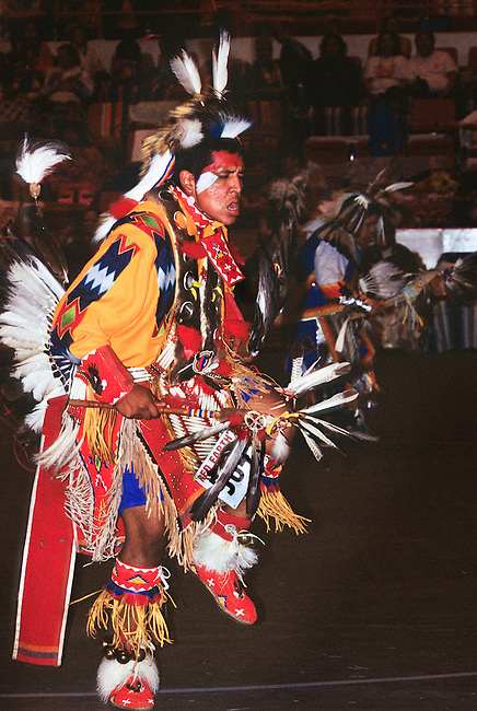 Traditional dancer dressed in colorful regalia during the Red Earth Indian Festival pow wow, Oklahoma City OK.