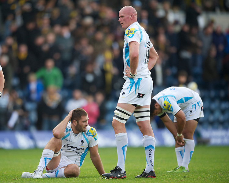 Worcester Warriors players look dejected in defeat (L-R) Sam Betty, Craig Gillies and Ravai Fatiaki after the final whistle of the Aviva Premiership match between London Wasps and Worcester Warriors at Adams Park on Sunday 7th October 2012 (Photo by Rob Munro)