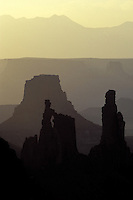 Distant view of buttes at sunrise from Mesa Arch, Canyonlands National Park, Utah