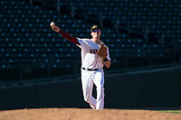 Mesa Solar Sox third baseman Bobby Dalbec (11), of the Boston Red Sox organization, throws to first base during an Arizona Fall League game against the Surprise Saguaros at Sloan Park on November 1, 2018 in Mesa, Arizona. Surprise defeated Mesa 5-4 . (Zachary Lucy/Four Seam Images)