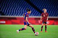 SAITAMA, JAPAN - JULY 24: Christen Press #11 of the United States crosses a ball during a game between New Zealand and USWNT at Saitama Stadium on July 24, 2021 in Saitama, Japan.