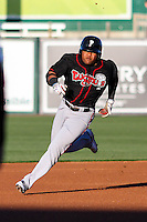 Lansing Lugnuts catcher Juan Kelly (25) races towards third base during a Midwest League game against the Wisconsin Timber Rattlers on April 29th, 2016 at Fox Cities Stadium in Appleton, Wisconsin.  Wisconsin defeated Lansing 2-0. (Brad Krause/Four Seam Images)