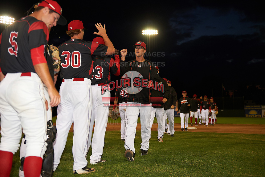 Batavia Muckdogs pitcher Connor Bach (35) high fives teammates after a game against the West Virginia Black Bears on June 28, 2016 at Dwyer Stadium in Batavia, New York.  Batavia defeated West Virginia 3-1.  (Mike Janes/Four Seam Images)