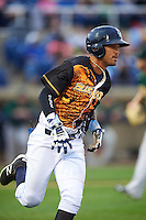 Wilmington Blue Rocks shortstop Humberto Arteaga (23) runs to first base during a game against the Lynchburg Hillcats on June 3, 2016 at Judy Johnson Field at Daniel S. Frawley Stadium in Wilmington, Delaware.  Lynchburg defeated Wilmington 16-11 in ten innings.  (Mike Janes/Four Seam Images)