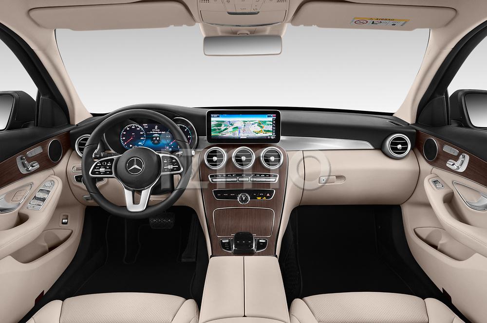Stock photo of straight dashboard view of a 2019 Mercedes Benz C Class Break Avantgarde 5 Door Wagon