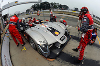 The #1 Audi Sport R15/TDI of Lucas Luhr & Marco Werner  makes a pit stop.