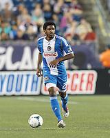 Philadelphia Union defender Sheanon Williams (25) brings the ball forward.  In a Major League Soccer (MLS) match, the New England Revolution (dark blue) defeated Philadelphia Union (light blue), 5-1, at Gillette Stadium on August 25, 2013.