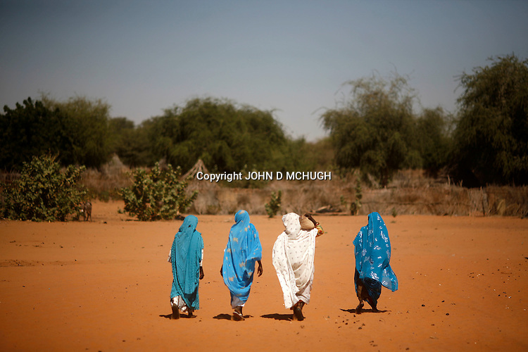 Women are seen in Gussa Djamat, near Klaimendo village in North Darfur, 05 Dec, 2008. Despite the fact that North Darfur is believed to currently have the highest concentration of NGOs in the world, the creation of Klaimendo district and village is the work of people born and raised in the area, rather than an outside aid agency. (John D McHugh)