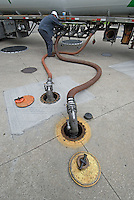 Harold Pickles drains a gasoline delivery hose into an underground tank after it was filled with 10,000 gallons of fuel Tuesday, Sept. 5, 2006, at a Westerville, Ohio, gas station. Regular gasoline was selling for $2.25 a gallon the day after Labor Day.<br />