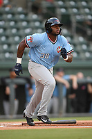 First baseman Tyreque Reed (38) of the Hickory Crawdads runs out a batted ball during a game against the Greenville Drive on Monday, August 20, 2018, at Fluor Field at the West End in Greenville, South Carolina. Hickory won, 11-2. (Tom Priddy/Four Seam Images)