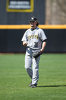 Logan Hutchinson (36) of the Kennesaw State Owls warms up in the outfield prior to the game against the prior to the game against the Winthrop Eagles at the Winthrop Ballpark on March 15, 2015 in Rock Hill, South Carolina.  The Eagles defeated the Owls 11-4.  (Brian Westerholt/Four Seam Images)