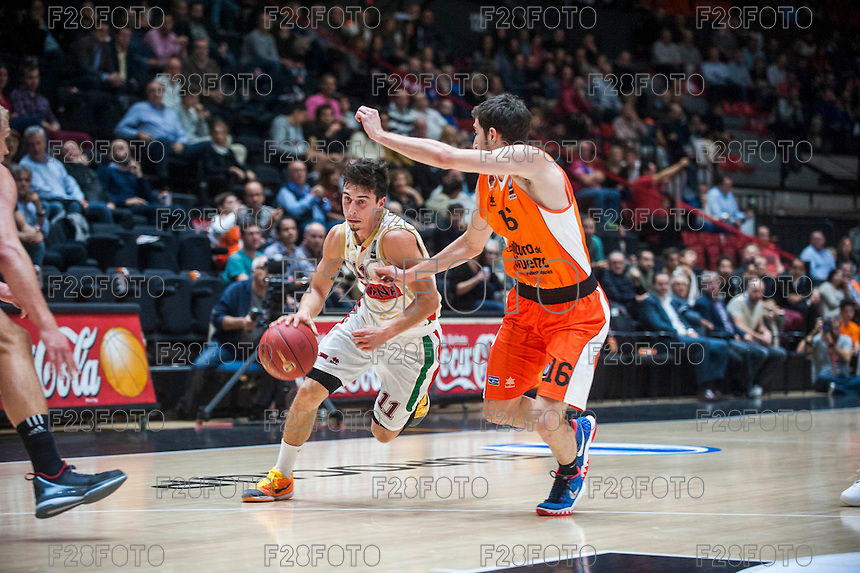 VALENCIA, SPAIN - NOVEMBER 3: Michele Ruzzier, Guillem Vives during EUROCUP match between Valencia Basket Club and CAI Zaragozaat Fonteta Stadium on November 3, 2015 in Valencia, Spain