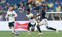 FOXBOROUGH, MA - JULY 18: Yordy Reyna #29 brings the ball forward as Luis Caicedo #27 defends during a game between Vancouver Whitecaps and New England Revolution at Gillette Stadium on July 18, 2019 in Foxborough, Massachusetts.