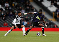 23rd May 2021; Craven Cottage, London, England; English Premier League Football, Fulham versus Newcastle United; Allan Saint-Maximin of Newcastle United marked by Kenny Tete of Fulham