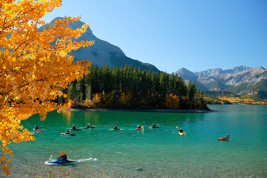 Kayakers on Barrier Lake, Bow Valley Provincial Park, Kananaskis Country, along Highway 40, Alberta, Canada.