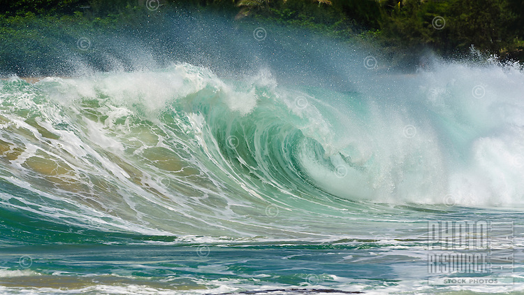 Big waves pound the shoreline on the North Shore of Kaua'i.