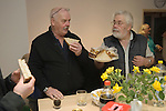 """Wassailers travel around the village of Curry Rivel Somerset on old New Years Eve, January 5th, singing a traditional wassailing song, and bidding the house holders """"... and a happy New Year"""", before being invited in for refreshment.  UK.  2016Paul <br /> <br /> Garry """"Budgie"""" Eagle and Ted ? with plate of sandwiches."""