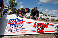 Aug 15, 2014; Brainerd, MN, USA; NHRA top fuel dragster driver Morgan Lucas (right) and crew chief Aaron Brooks during qualifying for the Lucas Oil Nationals at Brainerd International Raceway. Mandatory Credit: Mark J. Rebilas-