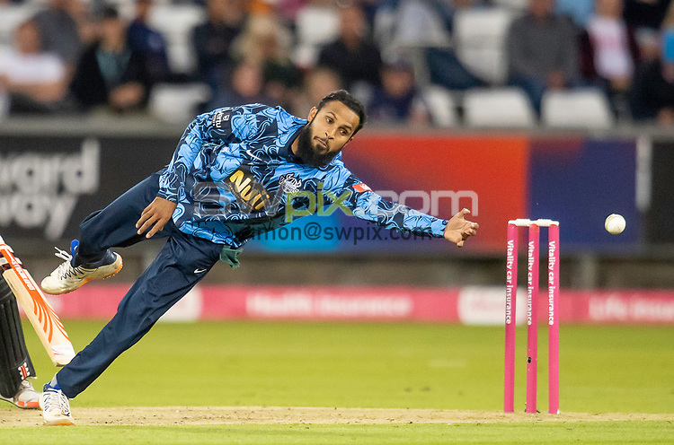 Picture by Allan McKenzie/SWpix.com - 24/08/2021 - Cricket - Vitality Blast Quarter Final - Yorkshire Vikings v Sussex Sharks - Emirates Durham ICG, Chester-le-Street, England - Viking's Adil Rashid attempts a catch from his own bowling against the Sharks.