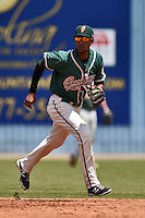 Greensboro Grasshoppers shortstop Rehiner Cordova #11 during a game against the  Asheville Tourists at McCormick Field June 29, 2014 in Asheville, North Carolina. The Grasshoppers defeated the Tourists 4-0. (Tony Farlow/Four Seam Images)