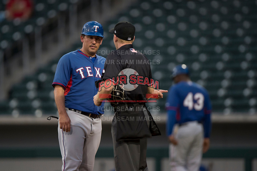 AZL Rangers manager Matt Siegel (22) argues a call made by home plate umpire Austin Nelson during an Arizona League game against the AZL Cubs 2 at Sloan Park on July 7, 2018 in Mesa, Arizona. AZL Rangers defeated AZL Cubs 2 11-2. (Zachary Lucy/Four Seam Images)