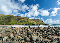 Mountain with a rocky shoreline in Halawa Valley on Moloka'i