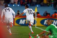 Landon Donovan (R) of USA celebrates scoring the winning goal against Algeria.