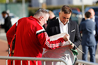 Pictured: Manager Carlos Carvalhal signs a welsh flag as he arrives. Wednesday 02 May 2018<br /> Re: Swansea City AFC Official Player Of The Season Awards Dinner 2018 at the Liberty Stadium, Wales, UK.