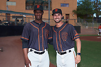 AZL Giants Black coaches Juan Ciriaco and Michael Johnson pose for a photo before an Arizona League game against the AZL Giants Orange on July 19, 2019 at the San Francisco Giants Baseball Complex in Scottsdale, Arizona. The AZL Giants Black defeated the AZL Giants Orange 8-5. (Zachary Lucy/Four Seam Images)