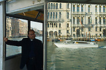 Water taxi Grand Canal Venice Italy 2009. Priest at vaporetto stop.
