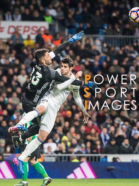 Goalkeeper Antoniio Adan of Real Betis clashes with Alvaro Morata of Real Madrid while saving a shot during their La Liga match between Real Madrid and Real Betis at the Santiago Bernabeu Stadium on 12 March 2017 in Madrid, Spain. Photo by Diego Gonzalez Souto / Power Sport Images