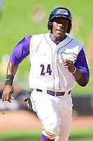 Jared Mitchell #24 of the Winston-Salem Dash hustles down the third base line against the Wilmington Blue Rocks at BB&T Ballpark on April 24, 2011 in Winston-Salem, North Carolina.   Photo by Brian Westerholt / Four Seam Images
