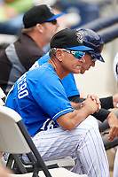 Biloxi Shuckers hitting coach Sandy Guerrero (16) in the dugout during a game against the Jackson Generals on April 23, 2017 at MGM Park in Biloxi, Mississippi.  Biloxi defeated Jackson 3-2.  (Mike Janes/Four Seam Images)