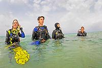Scuba divers after a dive on surface, Bonaire Island, Netherlands Antilles, Caribbean, Atlantic, model release