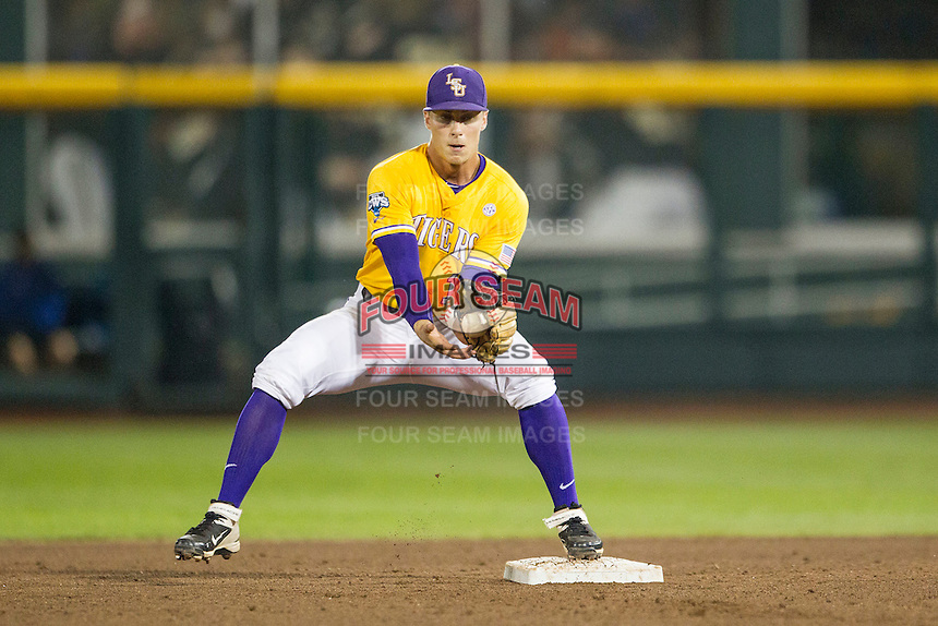 LSU Tigers second baseman Jared Foster (17) catches a ball at second against the TCU Horned Frogs in Game 10 of the NCAA College World Series on June 18, 2015 at TD Ameritrade Park in Omaha, Nebraska. TCU defeated the Tigers 8-4, eliminating LSU from the tournament. (Andrew Woolley/Four Seam Images)