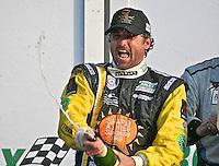 30 January 2011: Actor/driver Patrick Dempsey celebrates his first podium finish, Rolex 24 at Daytona, Daytona International Speedway, Daytona Beach, FL (Photo by Brian Cleary/www.bcpix.com)