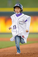 A young fan competes in a between innings contest at  BB&T Ballpark April 28, 2010, in Winston-Salem, North Carolina.  Photo by Brian Westerholt / Four Seam Images