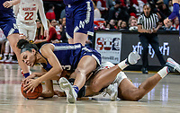 COLLEGE PARK, MD - JANUARY 26: Sydney Wood #3 of Northwestern goes over Shakira Austin #1 of Maryland for the ball during a game between Northwestern and Maryland at Xfinity Center on January 26, 2020 in College Park, Maryland.