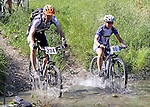 Nick Reeve (234) and Jackqui Keay (88)  go through the first ford. Mammoth Adventure MTB Ride, Nelson<br /> Photo: Marc Palmano/shuttersport.co.nz