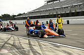 Scott Dixon, Chip Ganassi Racing Honda's  crew brings the car back to the garage after the rain shortened event