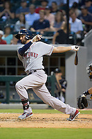 Deven Marrero (29) of the Pawtucket Red Sox follows through on his swing against the Charlotte Knights at BB&T Ballpark on August 9, 2014 in Charlotte, North Carolina.  The Red Sox defeated the Knights  5-2.  (Brian Westerholt/Four Seam Images)